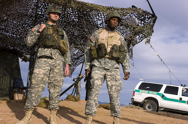 U.S. Army National Guard Soldiers watch the U.S./Mexico border