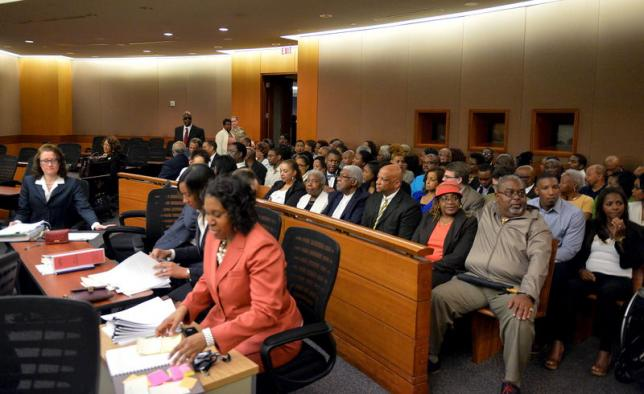 Former Atlanta public school educators fill the courtroom during the sentencing of 10 former educators convicted earlier this month of racketeering, in Atlanta