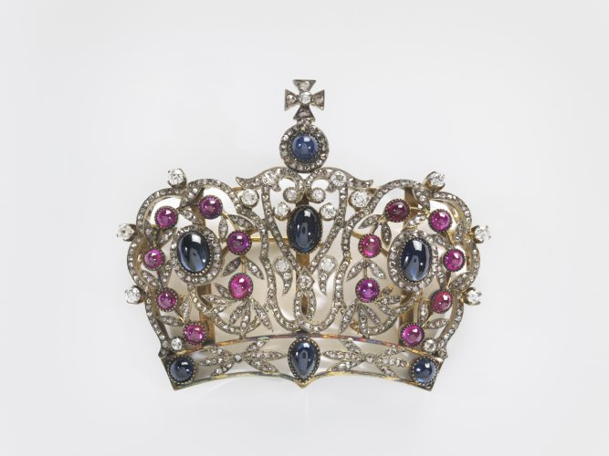 "Russian, 19th – 20th century Crown Brooch Silver gilt, sapphires, rubies, diamonds The openwork crown is set with cabochon sapphires, some of which are pear shaped; numerous cabochon rubies; and foliage set with rose-cut diamonds. A diamond-set cross surmounts the brooch. 2½""H x 3""W x 3/8""D 6.35 cm x 7.62 cm x 0.95 cm Note: brooch is probably the upper part of a panagia of the Virgin Mary. Image must be credited with the following collection and photo credit lines: Virginia Museum of Fine Arts, Richmond. Bequest of Lillian Thomas Pratt , 47.20.138 Photo: Travis Fullerton	        © Virginia Museum of Fine Arts"