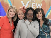 "THE VIEW -  It's official ! Raven-Symone was named co-host of ""The View,"" it was announced live today, Wednesday, June 10, 2015 on the ABC talk show.  After 37 appearances as guest co-host, the actress/producer joins the panel alongside moderator Whoopi Goldberg and co-hosts Nicolle Wallace and Rosie Perez effective immediately.  ""The View"" airs Monday-Friday (11:00 am-12:00 pm, ET) on the ABC Television Network.     (Photo by Lou Rocco/ABC via Getty Images)"