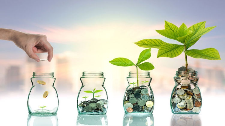 45039067 - hand putting mix coins and seed in clear bottle on cityscape photo blurred cityscape ,business investment growth concept