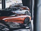 five-assorted-color-cars-parked-inside-room-1231643